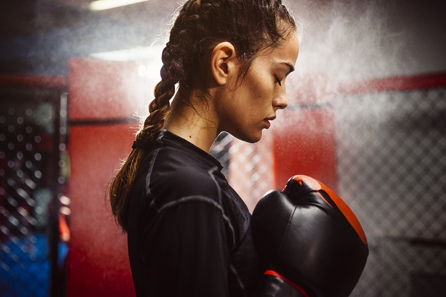 Female boxer in a boxing ring training