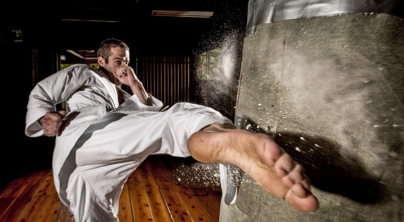 Karate kick into punching bag